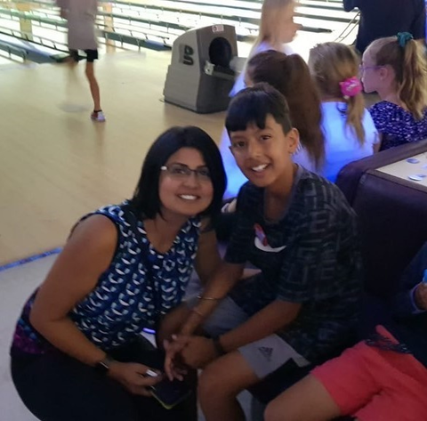 A mother and son at a bowling alley