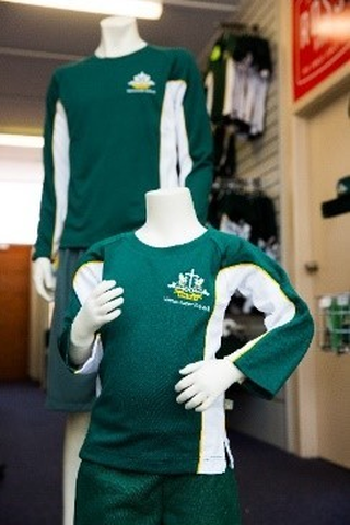 Two mannequins wearing sporting uniforms